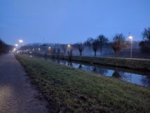 Foggy bikeway. Foggy morning bikeway. Gorinchem, Netherlands royalty free stock photography
