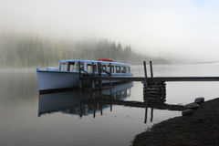 Foggy Boat on Lake Josephine Stock Images