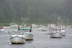 Foggy boats. Boats on a foggy rainy day Stock Photos