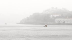 Foggy boats Stock Images