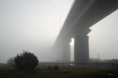 Foggy bridge. Bridge in a foggy morning nearby Kalmar in Sweden Stock Photography