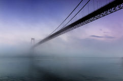 Foggy Bridge. Foggy evening along the Sotra Bridge outside of Bergen, Norway stock image