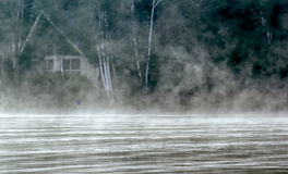 Foggy Cabin in the Woods Stock Photography