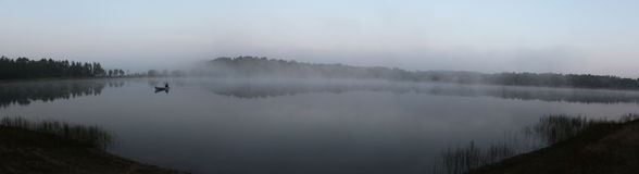 Foggy Canoe Stock Photography