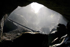 Foggy cave entrance, Romania Royalty Free Stock Image