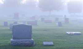 Foggy cemetery Royalty Free Stock Images