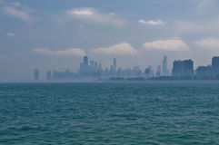 Foggy Chicago. Skyline in hot summer day Royalty Free Stock Photo