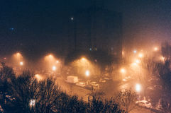 Foggy city streets at night Stock Image