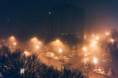 Foggy city streets at night Stock Image