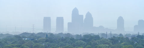 Foggy Cityscape. Panorama with highrise buildings on a rainy day Royalty Free Stock Photo