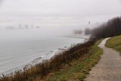 Foggy Cleveland, Ohio Skyline - Edgewater Reservation - Lake Erie. A view of a foggy Cleveland, Ohio skyline from Edgewater Reservation along the shores of Lake royalty free stock photos
