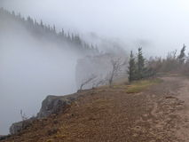 Foggy cliff edge. Fog rolling over cliff edge Stock Photography