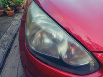 Foggy and cloudy car headlight lenses stock images