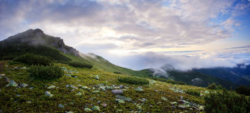 Foggy and cloudy mountains panorama Stock Images