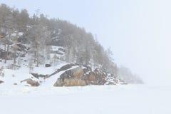 Foggy coast of the frozen winter sea. Royalty Free Stock Photography