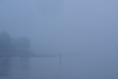 A foggy coastal morning on the Maine coast. A very foggy and calm morning on a beach in Maine Stock Images