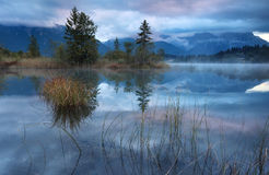 Foggy cold sunrise on alpine lake Barmsee Stock Photography
