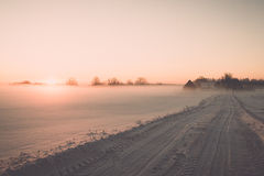 Foggy country fields in winter on cold morning - vintage effect Stock Photo