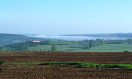 Foggy countryside in the morning. Foggy countryside arable land  in the morning,Veliko Tarnovo district,Bulgaria Royalty Free Stock Images
