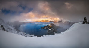 Foggy Crater Lake. The panoramic view of Crater Lake in partial fog after snow storm stock photo