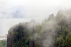 Foggy Crown Point. Vista House on Crown Point at Columbia River Gorge Oregon covered in low clouds fog Stock Photography