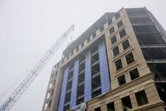 Foggy da over major construction site Stock Photos
