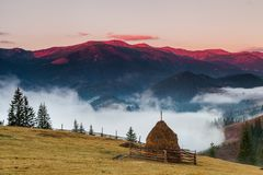 Foggy dawn in the autumn in the mountains. Stock Photography