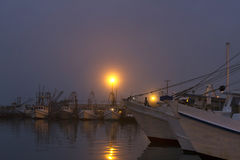 Foggy Dawn at the Harbor Royalty Free Stock Photography