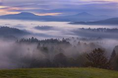 Foggy dawn over the Bohemian Switzerland Stock Images