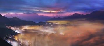 Foggy dawn on the show Stock Photos