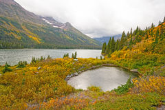 Foggy Day Fall Day on an Alpine Lake Royalty Free Stock Image