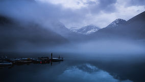 Foggy day in Norway. Fog is everywhere on morning near the Norwegians lake Royalty Free Stock Image