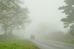 Foggy day on the roads. Bleak dreary foggy weather during December making road travel much more dangerous royalty free stock photo