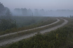 Foggy Dirt Road. A foggy dirt road in the early morning at Seney National Wildlife Refuge in Upper Michigan Stock Images