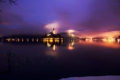 Foggy dusk in Bled lake Royalty Free Stock Image