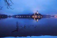 Foggy dusk in Bled lake Stock Photo