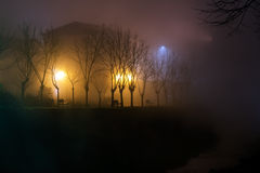 Foggy evening by the river. Nobody. Town empty, deserted. Stock Image