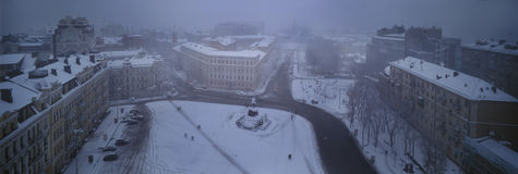 Foggy evening Sofia. Foggy evening view from the bell tower of St. Sophia Orthodox monastery opens a panorama of snow-covered town, the paths of which are single Royalty Free Stock Photos