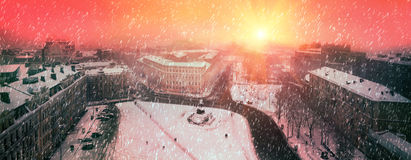 Foggy evening Sofia. Foggy evening view from the bell tower of St. Sophia Orthodox monastery opens a panorama of snow-covered town, the paths of which are single Royalty Free Stock Images