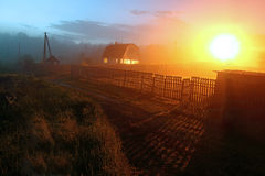 Foggy evening in the village. In Russia royalty free stock image