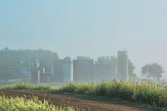 Foggy Farm Site. A foggy field and farm site Royalty Free Stock Photo