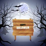 Foggy forest with wooden sign Halloween background Royalty Free Stock Photos