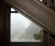 Foggy garden through staircase window Stock Image