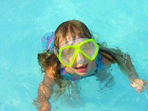 Foggy goggles. A young girl  looks up from the swimming pool with her googles all fogged up Royalty Free Stock Photography