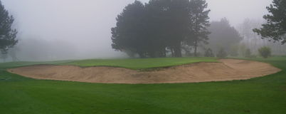 Foggy Golf Bunker. View of a golf bunker in the fog Stock Images