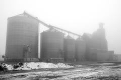 Foggy Grain Bins Stock Photo