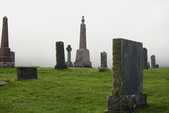 Foggy graveyard Royalty Free Stock Photography