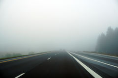 Foggy highway. On cold October morning with very little traffic stock photo