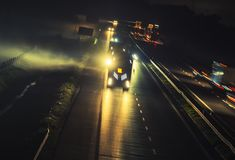 Foggy Highway Evening Traffic. Foggy Highway Evening Commute Traffic. Motion Blur Long Exposure Concept royalty free stock image