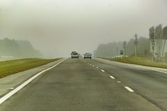 Foggy Highway, Uruguay. Foggy wheather highway at Montevideo outskirt, Uruguay stock photo